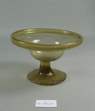 Egypto-Roman. <em>Bowl</em>, 4th century C.E. Glass, 2 3/8 x Diam. 3 11/16 in. (6.1 x 9.3 cm). Brooklyn Museum, Gift of Evangeline Wilbour Blashfield, Theodora Wilbour, and Victor Wilbour honoring the wishes of their mother, Charlotte Beebe Wilbour, as a memorial to their father, Charles Edwin Wilbour, 16.108.20. Creative Commons-BY (Photo: Brooklyn Museum, CUR.16.108.20_view1.jpg)