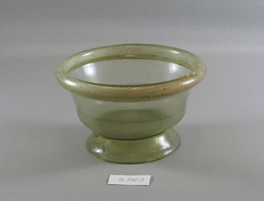 Egypto-Roman. <em>Bowl</em>, 4th century C.E. Glass, 2 9/16 x Diam. 5 15/16 in. (6.5 x 15.1 cm). Brooklyn Museum, Gift of Evangeline Wilbour Blashfield, Theodora Wilbour, and Victor Wilbour honoring the wishes of their mother, Charlotte Beebe Wilbour, as a memorial to their father, Charles Edwin Wilbour, 16.108.3. Creative Commons-BY (Photo: Brooklyn Museum, CUR.16.108.3_view1.jpg)