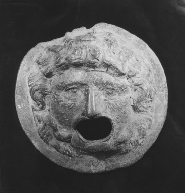 Graeco-Egyptian. <em>Medusa Mask</em>. Bronze or lead, 9 3/4 x 3 1/4 x 9 3/4 in. (24.7 x 8.2 x 24.8 cm). Brooklyn Museum, Gift of Evangeline Wilbour Blashfield, Theodora Wilbour, and Victor Wilbour honoring the wishes of their mother, Charlotte Beebe Wilbour, as a memorial to their father, Charles Edwin Wilbour, 16.111. Creative Commons-BY (Photo: Brooklyn Museum, CUR.16.111_NegB_print_bw.jpg)