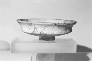 <em>Shallow Dish with Low Cylindrical Foot</em>, ca. 1539-1292 B.C.E. Egyptian alabaster, 1 7/8 x Diam. 6 in. (4.8 x 15.3 cm). Brooklyn Museum, Gift of Evangeline Wilbour Blashfield, Theodora Wilbour, and Victor Wilbour honoring the wishes of their mother, Charlotte Beebe Wilbour, as a memorial to their father, Charles Edwin Wilbour, 16.121. Creative Commons-BY (Photo: Brooklyn Museum, CUR.16.121_NegL1011_4_print_bw.jpg)