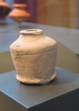 <em>Kohl Jar with Incised Figures</em>, ca. 1630-1539 B.C.E. Limestone, 2 3/8 x diam. at base 1 15/16 in. (6 x 4.9 cm). Brooklyn Museum, Gift of Evangeline Wilbour Blashfield, Theodora Wilbour, and Victor Wilbour honoring the wishes of their mother, Charlotte Beebe Wilbour, as a memorial to their father, Charles Edwin Wilbour, 16.122. Creative Commons-BY (Photo: Brooklyn Museum, CUR.16.122_erg2.jpg)