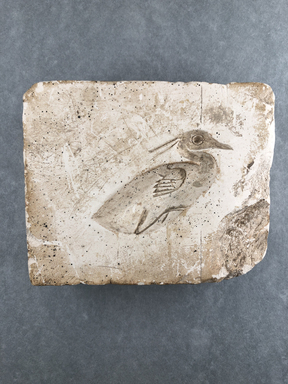 <em>Mold for Making a Benu Bird</em>. Soft limestone, 4 1/2 × 5 9/16 × 1 7/16 in. (11.5 × 14.1 × 3.6 cm). Brooklyn Museum, Gift of Evangeline Wilbour Blashfield, Theodora Wilbour, and Victor Wilbour honoring the wishes of their mother, Charlotte Beebe Wilbour, as a memorial to their father, Charles Edwin Wilbour, 16.128. Creative Commons-BY (Photo: , CUR.16.128_view01.jpg)