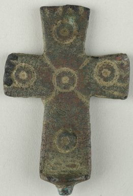 Coptic. <em>Cross</em>, 5th century C.E. Bronze, 1 5/16 x 1/8 x 2 1/4 in. (3.4 x 0.3 x 5.7 cm). Brooklyn Museum, Gift of Evangeline Wilbour Blashfield, Theodora Wilbour, and Victor Wilbour honoring the wishes of their mother, Charlotte Beebe Wilbour, as a memorial to their father, Charles Edwin Wilbour, 16.134. Creative Commons-BY (Photo: Brooklyn Museum (in collaboration with Index of Christian Art, Princeton University), CUR.16.134_ICA.jpg)