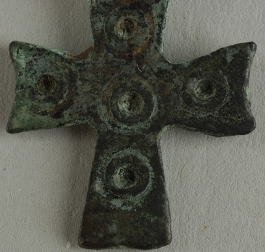 Coptic. <em>Cross Pendant</em>, 5th century C.E. Bronze, 5/8 × 1/16 × 1 in. (1.6 × 0.2 × 2.6 cm). Brooklyn Museum, Gift of Evangeline Wilbour Blashfield, Theodora Wilbour, and Victor Wilbour honoring the wishes of their mother, Charlotte Beebe Wilbour, as a memorial to their father, Charles Edwin Wilbour, 16.135. Creative Commons-BY (Photo: Brooklyn Museum (in collaboration with Index of Christian Art, Princeton University), CUR.16.135_detail01_ICA.jpg)