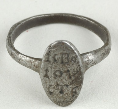 Coptic. <em>Finger Ring with Inscription</em>, 5th-7th century C.E. Iron, diameter: 3/4 in. (1.9 cm); bezel diameter: 9/16 in. (1.4 cm). Brooklyn Museum, Gift of Evangeline Wilbour Blashfield, Theodora Wilbour, and Victor Wilbour honoring the wishes of their mother, Charlotte Beebe Wilbour, as a memorial to their father, Charles Edwin Wilbour, 16.151. Creative Commons-BY (Photo: Brooklyn Museum (in collaboration with Index of Christian Art, Princeton University), CUR.16.151_view1_ICA.jpg)