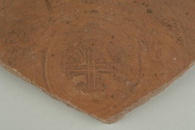 Coptic. <em>Stamped Bowl Fragment</em>, 6th century C.E. Clay, 3 5/8 x 3/8 x 4 in. (9.2 x 1 x 10.1 cm). Brooklyn Museum, Gift of Evangeline Wilbour Blashfield, Theodora Wilbour, and Victor Wilbour honoring the wishes of their mother, Charlotte Beebe Wilbour, as a memorial to their father, Charles Edwin Wilbour, 16.154.2. Creative Commons-BY (Photo: Brooklyn Museum (in collaboration with Index of Christian Art, Princeton University), CUR.16.154.2_detail01_ICA.jpg)