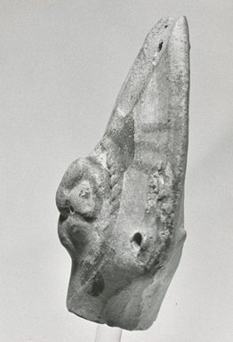 Coptic. <em>Head of Female Figurine</em>, 6th-7th century C.E. Terracotta, pigment, 2 5/16 x 1 7/8 x 15/16 in. (5.9 x 4.7 x 2.4 cm). Brooklyn Museum, Gift of Evangeline Wilbour Blashfield, Theodora Wilbour, and Victor Wilbour honoring the wishes of their mother, Charlotte Beebe Wilbour, as a memorial to their father, Charles Edwin Wilbour, 16.162. Creative Commons-BY (Photo: Brooklyn Museum, CUR.16.162_NegE_print_bw.jpg)