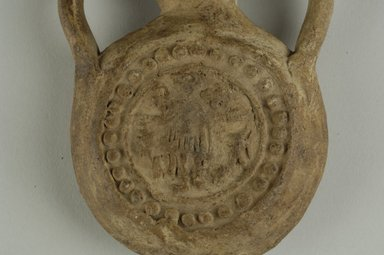 Coptic. <em>Pilgrim Flask</em>, 5th-7th century C.E. Terracotta, 4 5/16 x 2 15/16 in. (11 x 7.5 cm). Brooklyn Museum, Gift of Evangeline Wilbour Blashfield, Theodora Wilbour, and Victor Wilbour honoring the wishes of their mother, Charlotte Beebe Wilbour, as a memorial to their father, Charles Edwin Wilbour, 16.163. Creative Commons-BY (Photo: Brooklyn Museum (in collaboration with Index of Christian Art, Princeton University), CUR.16.163_detail01_ICA.jpg)