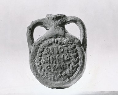 Coptic. <em>Ampulla of St. Menas</em>, 5th-7th century C.E. Terracotta, Length: 3 1/8 in. (8 cm). Brooklyn Museum, Gift of Evangeline Wilbour Blashfield, Theodora Wilbour, and Victor Wilbour honoring the wishes of their mother, Charlotte Beebe Wilbour, as a memorial to their father, Charles Edwin Wilbour, 16.164. Creative Commons-BY (Photo: Brooklyn Museum, CUR.16.164_NegF_print_bw.jpg)