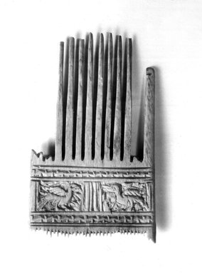 Coptic. <em>Double Comb</em>, 5th century C.E. Ivory, 3 7/16 × 2 3/16 in. (8.8 × 5.5 cm). Brooklyn Museum, Gift of Evangeline Wilbour Blashfield, Theodora Wilbour, and Victor Wilbour honoring the wishes of their mother, Charlotte Beebe Wilbour, as a memorial to their father, Charles Edwin Wilbour, 16.168. Creative Commons-BY (Photo: Brooklyn Museum, CUR.16.168_NegB_print_bw.jpg)