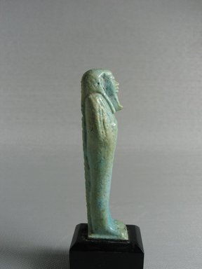 <em>Ushabti</em>, 664-332 B.C.E. Faience, 3 1/16 x 13/16 x 3/4 in. (7.8 x 2.1 x 1.9 cm). Brooklyn Museum, Gift of Evangeline Wilbour Blashfield, Theodora Wilbour, and Victor Wilbour honoring the wishes of their mother, Charlotte Beebe Wilbour, as a memorial to their father, Charles Edwin Wilbour, 16.178. Creative Commons-BY (Photo: Brooklyn Museum, CUR.16.178_view3.jpg)