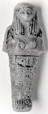 <em>Funerary Figurine of Nesi-ta-neb-ishru</em>, ca. 1075-945 B.C.E. Faience, height: 5 5/16 in. (13.5 cm); width at elbows: 2 5/16 in. (5.9 cm). Brooklyn Museum, Gift of Evangeline Wilbour Blashfield, Theodora Wilbour, and Victor Wilbour honoring the wishes of their mother, Charlotte Beebe Wilbour, as a memorial to their father, Charles Edwin Wilbour, 16.181. Creative Commons-BY (Photo: Brooklyn Museum, CUR.16.181_NegA_print_bw.jpg)