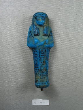 <em>Shabty of Nesi-ta-nebet-Isheru</em>, ca. 1075-945 B.C.E. Faience, 5 13/16 × 2 1/4 in. (14.7 × 5.7 cm). Brooklyn Museum, Gift of Evangeline Wilbour Blashfield, Theodora Wilbour, and Victor Wilbour honoring the wishes of their mother, Charlotte Beebe Wilbour, as a memorial to their father, Charles Edwin Wilbour, 16.186. Creative Commons-BY (Photo: Brooklyn Museum, CUR.16.186_front.jpg)