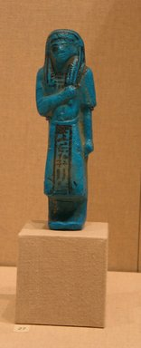 <em>Funerary Figurine of Nesikhonsu</em>, ca. 1075-945 B.C.E. Faience, 6 7/16 x  width at elbows 1 15/16 in. (16.4 x 4.9 cm). Brooklyn Museum, Gift of Evangeline Wilbour Blashfield, Theodora Wilbour, and Victor Wilbour honoring the wishes of their mother, Charlotte Beebe Wilbour, as a memorial to their father, Charles Edwin Wilbour, 16.187. Creative Commons-BY (Photo: Brooklyn Museum, CUR.16.187_wwgA-3.jpg)