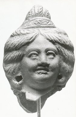 <em>Head of Female</em>, 2nd-3rd century C.E. Clay, 4 3/16 x 2 5/8 x 2 7/16 in. (10.7 x 6.7 x 6.3 cm). Brooklyn Museum, Gift of Evangeline Wilbour Blashfield, Theodora Wilbour, and Victor Wilbour honoring the wishes of their mother, Charlotte Beebe Wilbour, as a memorial to their father, Charles Edwin Wilbour, 16.220. Creative Commons-BY (Photo: Brooklyn Museum, CUR.16.220_NegA_print_bw.jpg)