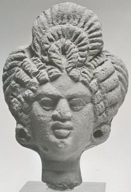 <em>Female Head</em>, ca. 3rd century C.E. Clay, pigment, 2 7/8 x 1 15/16 x 1 1/4 in. (7.3 x 4.9 x 3.1 cm). Brooklyn Museum, Gift of Evangeline Wilbour Blashfield, Theodora Wilbour, and Victor Wilbour honoring the wishes of their mother, Charlotte Beebe Wilbour, as a memorial to their father, Charles Edwin Wilbour, 16.225. Creative Commons-BY (Photo: Brooklyn Museum, CUR.16.225_NegA_print_bw.jpg)