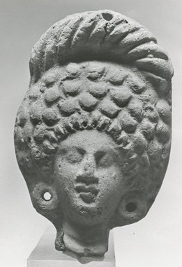 <em>Female Head</em>, 30 B.C.E.-395 C.E. Clay, pigment, 2 7/8 x 1 7/8 x 1 1/8 in. (7.3 x 4.8 x 2.8 cm). Brooklyn Museum, Gift of Evangeline Wilbour Blashfield, Theodora Wilbour, and Victor Wilbour honoring the wishes of their mother, Charlotte Beebe Wilbour, as a memorial to their father, Charles Edwin Wilbour, 16.227. Creative Commons-BY (Photo: Brooklyn Museum, CUR.16.227_NegA_print_bw.jpg)