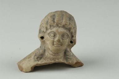 Coptic. <em>Female Head</em>, 5th-6th century C.E. Clay, pigment, 2 7/16 x 2 11/16 x 1 13/16 in. (6.2 x 6.8 x 4.6 cm). Brooklyn Museum, Gift of Evangeline Wilbour Blashfield, Theodora Wilbour, and Victor Wilbour honoring the wishes of their mother, Charlotte Beebe Wilbour, as a memorial to their father, Charles Edwin Wilbour, 16.232. Creative Commons-BY (Photo: Brooklyn Museum (in collaboration with Index of Christian Art, Princeton University), CUR.16.232_view1_ICA.jpg)
