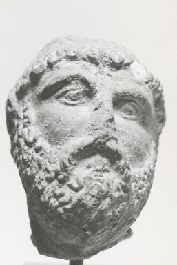 Graeco-Egyptian. <em>Male Portrait Head</em>, 3rd-2nd century B.C.E. Terracotta, 2 x 1 1/2 x 1 9/16 in. (5.1 x 3.8 x 3.9 cm). Brooklyn Museum, Gift of Evangeline Wilbour Blashfield, Theodora Wilbour, and Victor Wilbour honoring the wishes of their mother, Charlotte Beebe Wilbour, as a memorial to their father, Charles Edwin Wilbour, 16.234. Creative Commons-BY (Photo: Brooklyn Museum, CUR.16.234_NegC_print_bw.jpg)