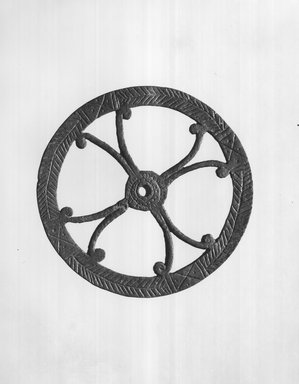 Possibly Egypto-Roman. <em>Disk or Wheel</em>, 2nd-4th century C.E. Bronze, 1/2 × Diam. 5 3/8 in. (1.3 × 13.7 cm). Brooklyn Museum, Gift of Evangeline Wilbour Blashfield, Theodora Wilbour, and Victor Wilbour honoring the wishes of their mother, Charlotte Beebe Wilbour, as a memorial to their father, Charles Edwin Wilbour, 16.235. Creative Commons-BY (Photo: Brooklyn Museum, CUR.16.235_print_negA_bw.jpg)
