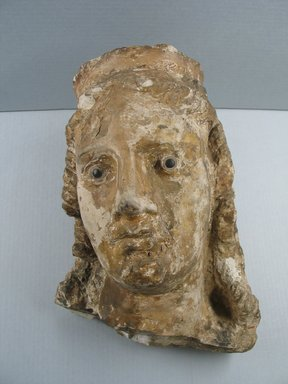 Graeco-Egyptian. <em>Female Head</em>, 1st century B.C.E.-1st century C.E. Limestone, stone, pigment, 14 x 10 1/4 in. (35.5 x 26 cm). Brooklyn Museum, Gift of Evangeline Wilbour Blashfield, Theodora Wilbour, and Victor Wilbour honoring the wishes of their mother, Charlotte Beebe Wilbour, as a memorial to their father, Charles Edwin Wilbour, 16.236. Creative Commons-BY (Photo: , CUR.16.236_view01.jpg)