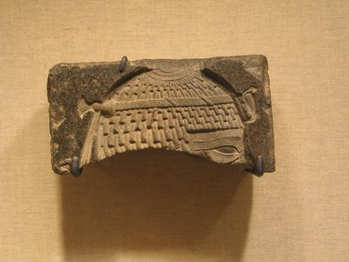 <em>Fragmentary Relief of a King</em>, ca. 664-525 B.C.E. Basalt, 2 11/16 × 5 1/2 × 2 in. (6.8 × 13.9 × 5.1 cm). Brooklyn Museum, Gift of Evangeline Wilbour Blashfield, Theodora Wilbour, and Victor Wilbour honoring the wishes of their mother, Charlotte Beebe Wilbour, as a memorial to their father, Charles Edwin Wilbour, 16.237. Creative Commons-BY (Photo: Brooklyn Museum, CUR.16.237_wwg8.jpg)