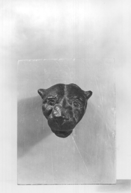 <em>Panther Head</em>, 30 B.C.E.-100 C.E. Bronze, 2 5/8 × Diam. of base 1 1/8 in. (6.7 × 2.9 cm). Brooklyn Museum, Gift of Evangeline Wilbour Blashfield, Theodora Wilbour, and Victor Wilbour honoring the wishes of their mother, Charlotte Beebe Wilbour, as a memorial to their father, Charles Edwin Wilbour, 16.249. Creative Commons-BY (Photo: Brooklyn Museum, CUR.16.249_NegA_print_bw.jpg)