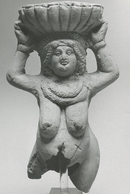 <em>Fragmentary Statuette of a Woman</em>, 3rd-4th century C.E. Clay, 5 11/16 x 3 3/8 x 2 1/2 in. (14.4 x 8.5 x 6.4 cm). Brooklyn Museum, Gift of Evangeline Wilbour Blashfield, Theodora Wilbour, and Victor Wilbour honoring the wishes of their mother, Charlotte Beebe Wilbour, as a memorial to their father, Charles Edwin Wilbour, 16.266. Creative Commons-BY (Photo: Brooklyn Museum, CUR.16.266_NegC_print_bw.jpg)