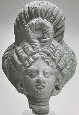 <em>Female Head</em>, 101 C.E.-300 C.E. Clay, 3 7/16 x 2 3/8 x 1 5/16 in. (8.8 x 6.1 x 3.4 cm). Brooklyn Museum, Gift of Evangeline Wilbour Blashfield, Theodora Wilbour, and Victor Wilbour honoring the wishes of their mother, Charlotte Beebe Wilbour, as a memorial to their father, Charles Edwin Wilbour, 16.268. Creative Commons-BY (Photo: Brooklyn Museum, CUR.16.268_NegA_print_bw.jpg)