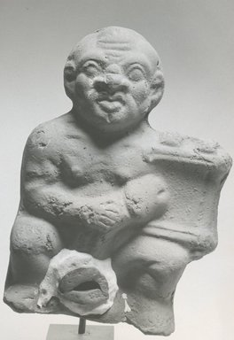 <em>Ithyphallic Man with a Harp</em>, 3rd-4th century C.E. Terracotta, pigment, 5 11/16 x 3 7/8 x 2 3/16 in. (14.4 x 9.8 x 5.6 cm). Brooklyn Museum, Gift of Evangeline Wilbour Blashfield, Theodora Wilbour, and Victor Wilbour honoring the wishes of their mother, Charlotte Beebe Wilbour, as a memorial to their father, Charles Edwin Wilbour, 16.271. Creative Commons-BY (Photo: Brooklyn Museum, CUR.16.271_NegC_print_bw.jpg)