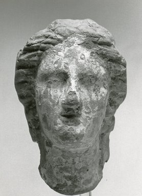 <em>Female Head</em>, ca. 170 B.C.E.-100 C.E. Clay, pigment, 3 1/4 x 2 5/16 x 3 in. (8.3 x 5.9 x 7.6 cm). Brooklyn Museum, Gift of Evangeline Wilbour Blashfield, Theodora Wilbour, and Victor Wilbour honoring the wishes of their mother, Charlotte Beebe Wilbour, as a memorial to their father, Charles Edwin Wilbour, 16.288. Creative Commons-BY (Photo: Brooklyn Museum, CUR.16.288_NegA_print_bw.jpg)