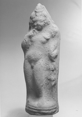<em>Statuette of the Child Horus</em>, 2nd-3rd century C.E. Terracotta, pigment, 7 3/16 x 2 7/16 x 1 1/4 in. (18.2 x 6.3 x 3.2 cm). Brooklyn Museum, Gift of Evangeline Wilbour Blashfield, Theodora Wilbour, and Victor Wilbour honoring the wishes of their mother, Charlotte Beebe Wilbour, as a memorial to their father, Charles Edwin Wilbour, 16.290. Creative Commons-BY (Photo: Brooklyn Museum, CUR.16.290_NegA_print_bw.jpg)