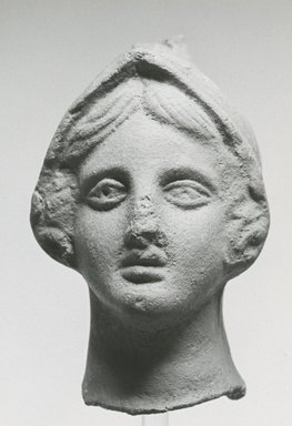 Graeco-Egyptian. <em>Female Head</em>, 30 B.C.E.-100 C.E. Clay, pigment, 2 7/8 x 1 5/8 x 2 1/4 in. (7.3 x 4.2 x 5.7 cm). Brooklyn Museum, Gift of Evangeline Wilbour Blashfield, Theodora Wilbour, and Victor Wilbour honoring the wishes of their mother, Charlotte Beebe Wilbour, as a memorial to their father, Charles Edwin Wilbour, 16.293. Creative Commons-BY (Photo: Brooklyn Museum, CUR.16.293_NegA_print_bw.jpg)