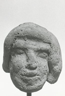 Egyptian. <em>Male Head</em>, 525-404 B.C.E., 343-332 B.C.E. or 30 B.C.E.-395 C.E. Terracotta, 1 15/16 × 1 11/16 × 1 3/4 in. (4.9 × 4.3 × 4.4 cm). Brooklyn Museum, Gift of Evangeline Wilbour Blashfield, Theodora Wilbour, and Victor Wilbour honoring the wishes of their mother, Charlotte Beebe Wilbour, as a memorial to their father, Charles Edwin Wilbour, 16.303. Creative Commons-BY (Photo: Brooklyn Museum, CUR.16.303_NegB_print_bw.jpg)
