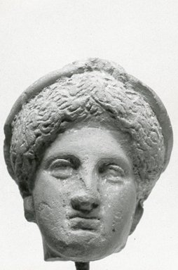Greek. <em>Female Head</em>, late 5th to 4th century B.C.E. Clay, pigment, 1 5/16 x 1 1/8 x 1 in. (3.4 x 2.8 x 2.6 cm). Brooklyn Museum, Gift of Evangeline Wilbour Blashfield, Theodora Wilbour, and Victor Wilbour honoring the wishes of their mother, Charlotte Beebe Wilbour, as a memorial to their father, Charles Edwin Wilbour, 16.308. Creative Commons-BY (Photo: Brooklyn Museum, CUR.16.308_NegA_print_bw.jpg)