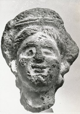 <em>Female Head</em>, 3rd century C.E. Clay, pigment, 3 1/16 x 2 5/16 x 1 13/16 in. (7.8 x 5.8 x 4.7 cm). Brooklyn Museum, Gift of Evangeline Wilbour Blashfield, Theodora Wilbour, and Victor Wilbour honoring the wishes of their mother, Charlotte Beebe Wilbour, as a memorial to their father, Charles Edwin Wilbour, 16.310. Creative Commons-BY (Photo: Brooklyn Museum, CUR.16.310_NegA_print_bw.jpg)