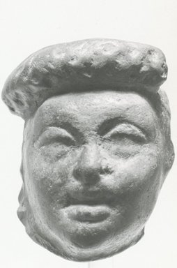 <em>Mask or Head</em>, 1st-4th century C.E. Terracotta, pigment, 1 1/2 x 1 1/4 in. (3.9 x 3.2 cm). Brooklyn Museum, Gift of Evangeline Wilbour Blashfield, Theodora Wilbour, and Victor Wilbour honoring the wishes of their mother, Charlotte Beebe Wilbour, as a memorial to their father, Charles Edwin Wilbour, 16.315. Creative Commons-BY (Photo: Brooklyn Museum, CUR.16.315_NegA_print_bw.jpg)