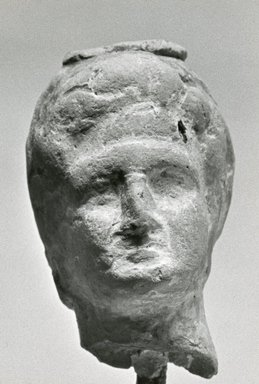 Greek. <em>Small Female Head</em>, 170 B.C.E.-100 C.E. Clay, pigment, 1 9/16 x 15/16 x 1 1/8 in. (3.9 x 2.5 x 2.8 cm). Brooklyn Museum, Gift of Evangeline Wilbour Blashfield, Theodora Wilbour, and Victor Wilbour honoring the wishes of their mother, Charlotte Beebe Wilbour, as a memorial to their father, Charles Edwin Wilbour, 16.316. Creative Commons-BY (Photo: Brooklyn Museum, CUR.16.316_NegA_print_bw.jpg)