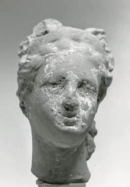 Greek. <em>Female Head</em>, 170 B.C.E.-100 C.E. Clay, pigment, 2 7/16 x 1 7/16 x 1 1/2 in. (6.2 x 3.6 x 3.8 cm). Brooklyn Museum, Gift of Evangeline Wilbour Blashfield, Theodora Wilbour, and Victor Wilbour honoring the wishes of their mother, Charlotte Beebe Wilbour, as a memorial to their father, Charles Edwin Wilbour, 16.317. Creative Commons-BY (Photo: Brooklyn Museum, CUR.16.317_NegA_print_bw.jpg)