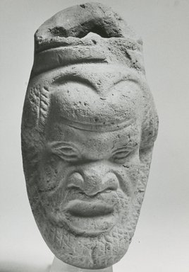 <em>Container with Face of a Satyr</em>, 30 B.C.E.-100 C.E. Terracotta, pigment, 4 7/16 x 2 3/16 x 2 1/8 in. (11.3 x 5.6 x 5.4 cm). Brooklyn Museum, Gift of Evangeline Wilbour Blashfield, Theodora Wilbour, and Victor Wilbour honoring the wishes of their mother, Charlotte Beebe Wilbour, as a memorial to their father, Charles Edwin Wilbour, 16.318. Creative Commons-BY (Photo: Brooklyn Museum, CUR.16.318_NegA_print_bw.jpg)