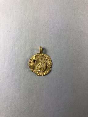 <em>Circular Disk</em>, 1st-2nd century C.E. Gold, 1/8 × 3/4 × 15/16 in. (0.3 × 1.9 × 2.4 cm). Brooklyn Museum, Gift of Evangeline Wilbour Blashfield, Theodora Wilbour, and Victor Wilbour honoring the wishes of their mother, Charlotte Beebe Wilbour, as a memorial to their father, Charles Edwin Wilbour, 16.321. Creative Commons-BY (Photo: , CUR.16.321_view01.jpg)