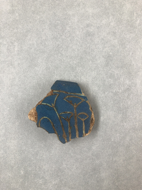 <em>Bowl Fragment</em>, ca. 1352-1332 B.C.E. Faience, 1 3/4 × 3/8 × 1 15/16 in. (4.5 × 1 × 5 cm). Brooklyn Museum, Gift of Evangeline Wilbour Blashfield, Theodora Wilbour, and Victor Wilbour honoring the wishes of their mother, Charlotte Beebe Wilbour, as a memorial to their father, Charles Edwin Wilbour, 16.341. Creative Commons-BY (Photo: , CUR.16.341_view01.jpg)