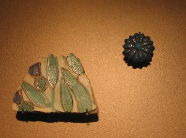 <em>Floral Amarna</em>, ca. 1352-1336 B.C.E. Faience, 2 x 2 15/16 in. (5.1 x 7.5 cm). Brooklyn Museum, Gift of the Egypt Exploration Society, 37.411. Creative Commons-BY (Photo: , CUR.16.345_37.411_erg456.jpg)