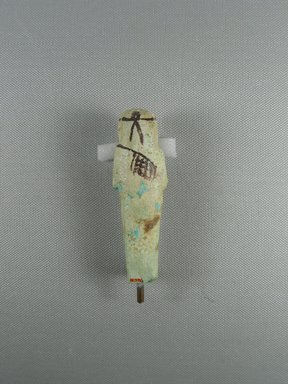 <em>Ushabti</em>, ca. 1075-656 B.C.E. Faience, height: 3 11/16 in. (9.3 cm); width: 1 1/8 in. (2.9 cm). Brooklyn Museum, Gift of Evangeline Wilbour Blashfield, Theodora Wilbour, and Victor Wilbour honoring the wishes of their mother, Charlotte Beebe Wilbour, as a memorial to their father, Charles Edwin Wilbour, 16.376. Creative Commons-BY (Photo: Brooklyn Museum, CUR.16.376_view4.jpg)