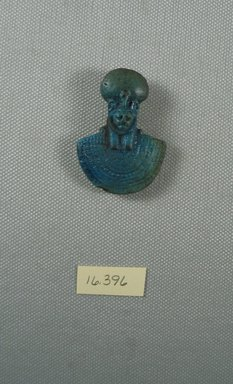 <em>Aegis</em>. Faience, 1 15/16 x 1 3/8 in. (4.9 x 3.5 cm). Brooklyn Museum, Gift of Evangeline Wilbour Blashfield, Theodora Wilbour, and Victor Wilbour honoring the wishes of their mother, Charlotte Beebe Wilbour, as a memorial to their father, Charles Edwin Wilbour, 16.396. Creative Commons-BY (Photo: Brooklyn Museum, CUR.16.396_View1.jpg)