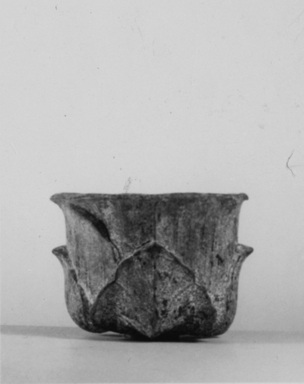 Graeco-Egyptian. <em>Vessel</em>, 30 B.C.E.-100 C.E. Metal, 1 5/8 × 2 5/16 in. (4.1 × 5.8 cm). Brooklyn Museum, Gift of Evangeline Wilbour Blashfield, Theodora Wilbour, and Victor Wilbour honoring the wishes of their mother, Charlotte Beebe Wilbour, as a memorial to their father, Charles Edwin Wilbour, 16.403. Creative Commons-BY (Photo: , CUR.16.403_noneg_print_bw.jpg)