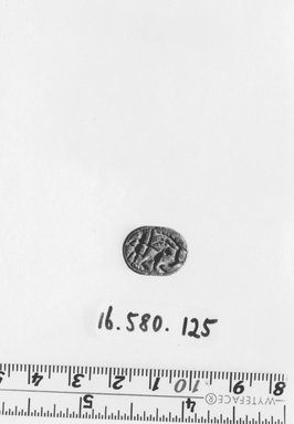 Nubian. <em>Scarab</em>. Steatite, glaze, 1/4 x 1/2 x 5/8 in. (0.7 x 1.2 x 1.6 cm). Brooklyn Museum, Gift of Evangeline Wilbour Blashfield, Theodora Wilbour, and Victor Wilbour honoring the wishes of their mother, Charlotte Beebe Wilbour, as a memorial to their father, Charles Edwin Wilbour, 16.580.125. Creative Commons-BY (Photo: Brooklyn Museum, CUR.16.580.125_negA_print_bw.jpg)