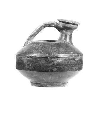 <em>Stirrup Jug</em>. Clay, 5 1/8 x Diam. 5 1/16 in. (13 x 12.8 cm). Brooklyn Museum, Gift of Evangeline Wilbour Blashfield, Theodora Wilbour, and Victor Wilbour honoring the wishes of their mother, Charlotte Beebe Wilbour, as a memorial to their father, Charles Edwin Wilbour, 16.580.133. Creative Commons-BY (Photo: Brooklyn Museum, CUR.16.580.133_NegA_print_bw.jpg)