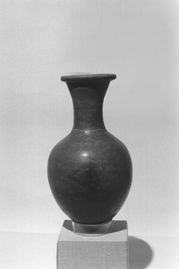 <em>Water Bottle</em>, ca. 1539-1425 B.C.E. Clay, 8 7/8 x Diam. 5 in. (22.5 x 12.7 cm). Brooklyn Museum, Gift of Evangeline Wilbour Blashfield, Theodora Wilbour, and Victor Wilbour honoring the wishes of their mother, Charlotte Beebe Wilbour, as a memorial to their father Charles Edwin Wilbour, 16.580.134. Creative Commons-BY (Photo: Brooklyn Museum, CUR.16.580.134_NegL1009-32_print_bw.jpg)