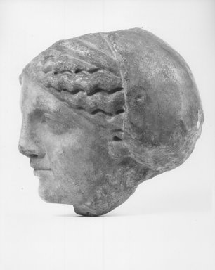 Graeco-Egyptian. <em>Head of a Woman</em>, 2nd century B.C.E. Marble, 5 7/8 x 5 1/16 in. (15 x 12.8 cm). Brooklyn Museum, Gift of Evangeline Wilbour Blashfield, Theodora Wilbour, and Victor Wilbour honoring the wishes of their mother, Charlotte Beebe Wilbour, as a memorial to their father, Charles Edwin Wilbour, 16.580.162. Creative Commons-BY (Photo: Brooklyn Museum, CUR.16.580.162_NegB_print.bw.jpg)